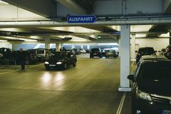 Interior of underground parking with Ausfahrt translated as Exit. FRANKFURT, GERMANY - DEC 21, 2016: Interior of underground parking with Ausfahrt translated as Royalty Free Stock Photos