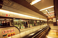 Interior of the underground station of asian city and passengers inside trains Royalty Free Stock Image