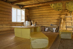 The interior is an unfinished log home Royalty Free Stock Photography