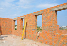 Interior of a unfinished red brick house under construction. Royalty Free Stock Photos