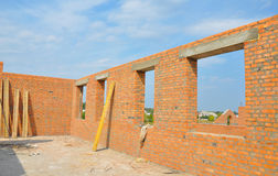 Interior of a Unfinished Red Brick House Walls under Construction without Roofing Stock Photo