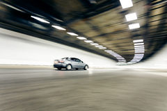 Interior of an urban tunnel with car,motion blur Royalty Free Stock Photo