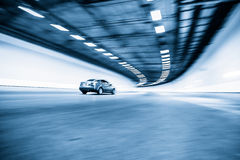 Interior of an urban tunnel with car,motion blur Stock Images
