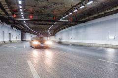Interior of an urban tunnel with car,motion blur Royalty Free Stock Image