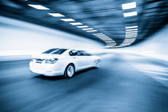 Interior of an urban tunnel with car,motion blur Stock Photo
