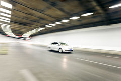 Interior of an urban tunnel with car,motion blur Stock Photos