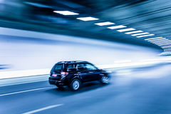 Interior of an urban tunnel with car,motion blur Stock Photography