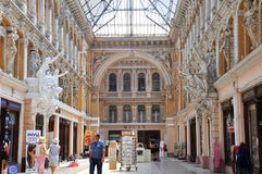 The building of the `Passage` complex includes halls with a glass roof and a hotel, with the same name. Ukraine. Odessa. The interior uses Moorish style and stock photos