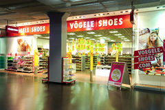 Interior of Vögele fashion shoes store Stock Image