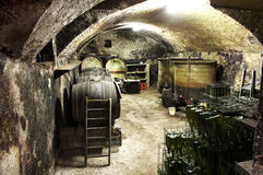 Interior of a vaulted wine cellar with old casks Royalty Free Stock Photos