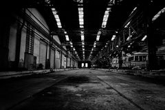 Interior of a vehicle repair station in black and white. Industrial interior of a vehicle repair station Royalty Free Stock Photos