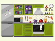 Interior verde de la cocina con los utensilios, la comida y los dispositivos Foto de archivo libre de regalías