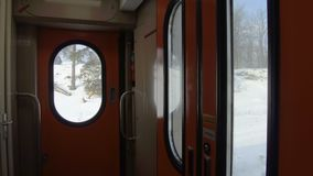 Interior of the vestibule of a passenger train car.  stock footage