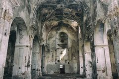Interior view of abandoned and damaged Church stock photography