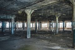 Interior view of the abandoned Fisher Body Plant factory in Detroit. The plant is abandoned and vacant ever since. Photo taken in Detroit royalty free stock image