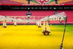 Interior view of Amsterdam Ajax Football Arena. System of care and sprinkling of the lawn at the stadium. Amsterdam, Netherlands - April, 2017: Interior view of stock images