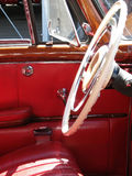 Interior view of an antique car. Antique car with red leather interior Stock Image