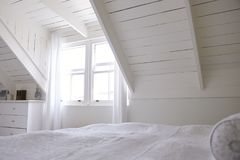 Interior View Of Beautiful Light And Airy White Bedroom royalty free stock images
