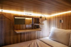 Interior view of capsule hotel in downtown stock images