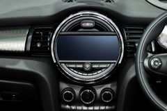 Interior view of car. Modern technology car dashboard, radio and. Aircondition control button Stock Photography