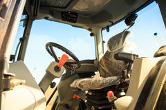 interior view of cultivator tractor cabin with steering wheel Royalty Free Stock Image