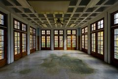 Derelict Ward - Abandoned Laurelton State School & Hospital - Pennsylvania. An interior view of a derelict ward with blue painted walls and eleven windows at Stock Photos