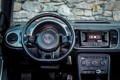 Interior view from driver position over luxury coupe car dashboard Royalty Free Stock Images