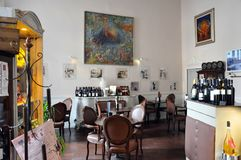 Inside view of an elegant bar. Interior view of an elegant bar in the medieval village of Agnone. The bar which is called literary, has a decor beginning 900 royalty free stock images