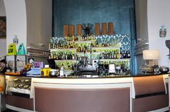 Inside view of an elegant bar. Interior view of an elegant bar in the medieval village of Agnone. The bar which is called literary, has a decor beginning 900 stock photography