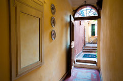 Interior view from hallway through open door to courtyard of an Stock Photo