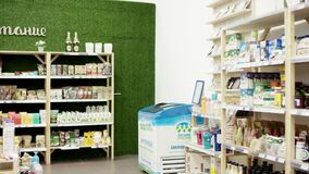 Interior view of healthy food store, camera moving from right to center showing grocery products and beverages nicely