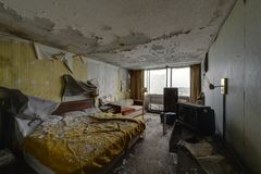 Intact Lodging Room with Bed & Furniture - Abandoned Hotel Royalty Free Stock Photos