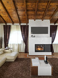 Interior view of a  living room with fireplace Royalty Free Stock Images
