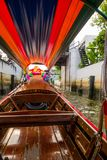 Interior view of a long tail boat with front view sailing at yai canal or Khlong Bang Luang Tourist Attraction in. Thailand Royalty Free Stock Photos