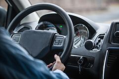Interior view of a man driving a car. With his hand Stock Photos