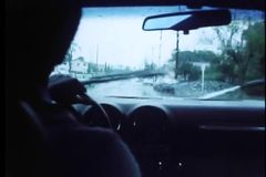 Interior view of man driving car in the rain stock video