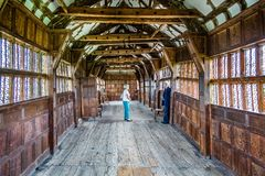 Interior view of medieval tudor long gallery in Little Moreton Hall in Moreton, Cheshire, UK stock image