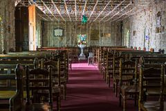 Interior view of a modern church. With empty pews stock images