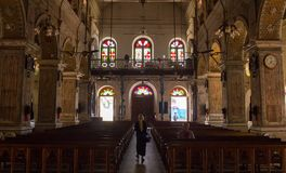 Interior view of a modern church. With empty pews royalty free stock images