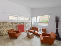 Interior view of a modern living. Room with orange sofa ans marble floor and stone wall Royalty Free Stock Photography