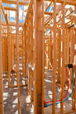 An interior view of a new home under construction with exposed w Stock Image