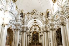 Altar and stone columns in old cathedral Royalty Free Stock Images