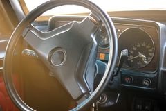 Interior view of old vintage car. steering wheel stock image