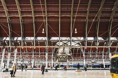 Interior view of Paddington station, one of London`s main transportation hubs. Locals and tourists commuting. London, UK - March 20 2018: Interior view of stock image