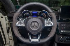 Interior view with steeering wheel and dashboard of luxury very expensive new white Mercedes-Benz GLE Coupe AMG 63s car stands in. Novosibirsk, Russia - 08.01.18 royalty free stock photo