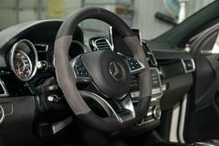 Interior view with steeering wheel and dashboard of luxury very expensive new white Mercedes-Benz GLE Coupe AMG 63s car stands in. Novosibirsk, Russia - 08.01.18 royalty free stock photography