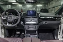 Interior view with steeering wheel and dashboard of luxury very expensive new white Mercedes-Benz GLE Coupe AMG 63s car stands in. Novosibirsk, Russia - 08.01.18 royalty free stock photos