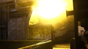 Interior view of steel mill with huge ladle of burning metal alloy. Footage. View of open-hearth furnace with bright stock photography