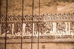 CAIRO, EGYPT - Nov 2009: Arabic writing on a wall inside the Sultan Hassan mosque in Cairo royalty free stock photography