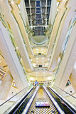 Interior view of Taipei 101 mall with layers of escalators in Taipei Stock Photo